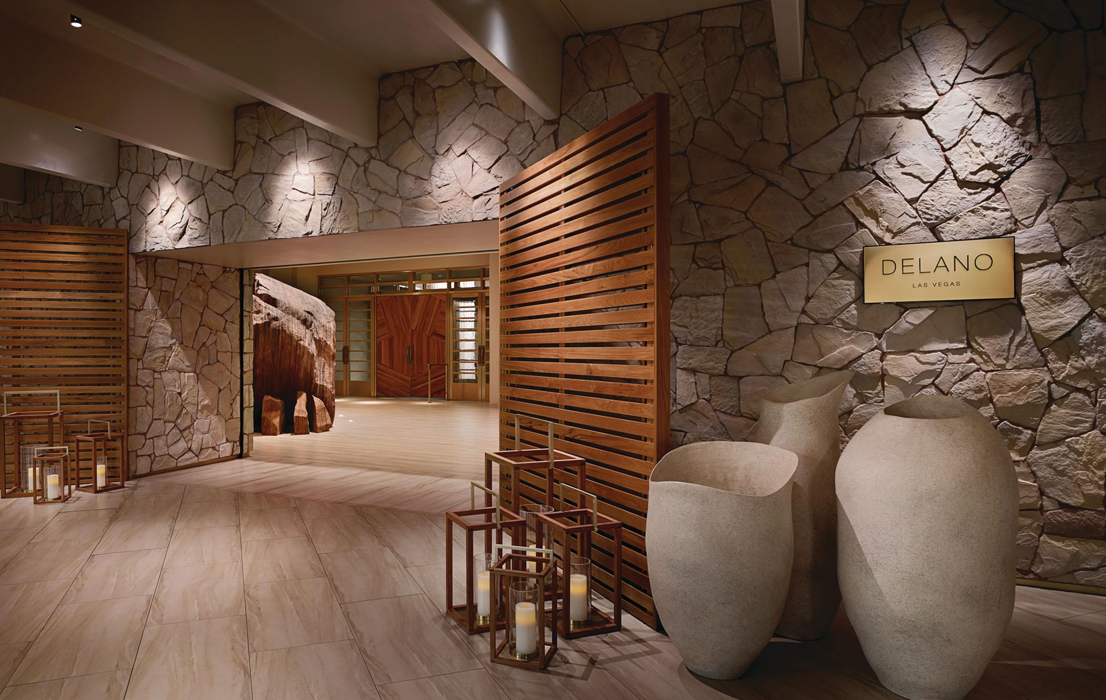 Hotel entrance surrounded by stone walls