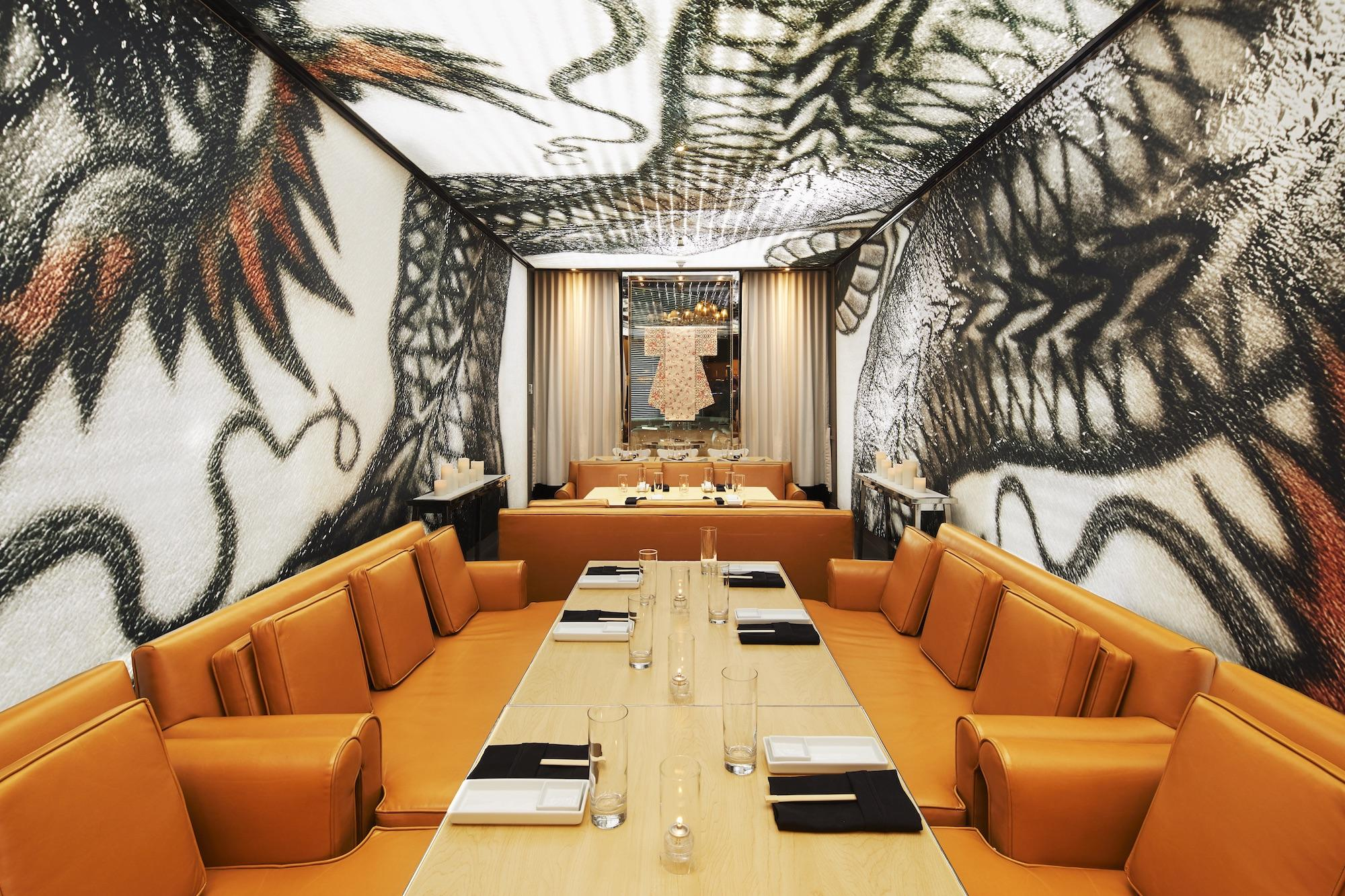 private dining room with wall and ceiling murals of a dragon