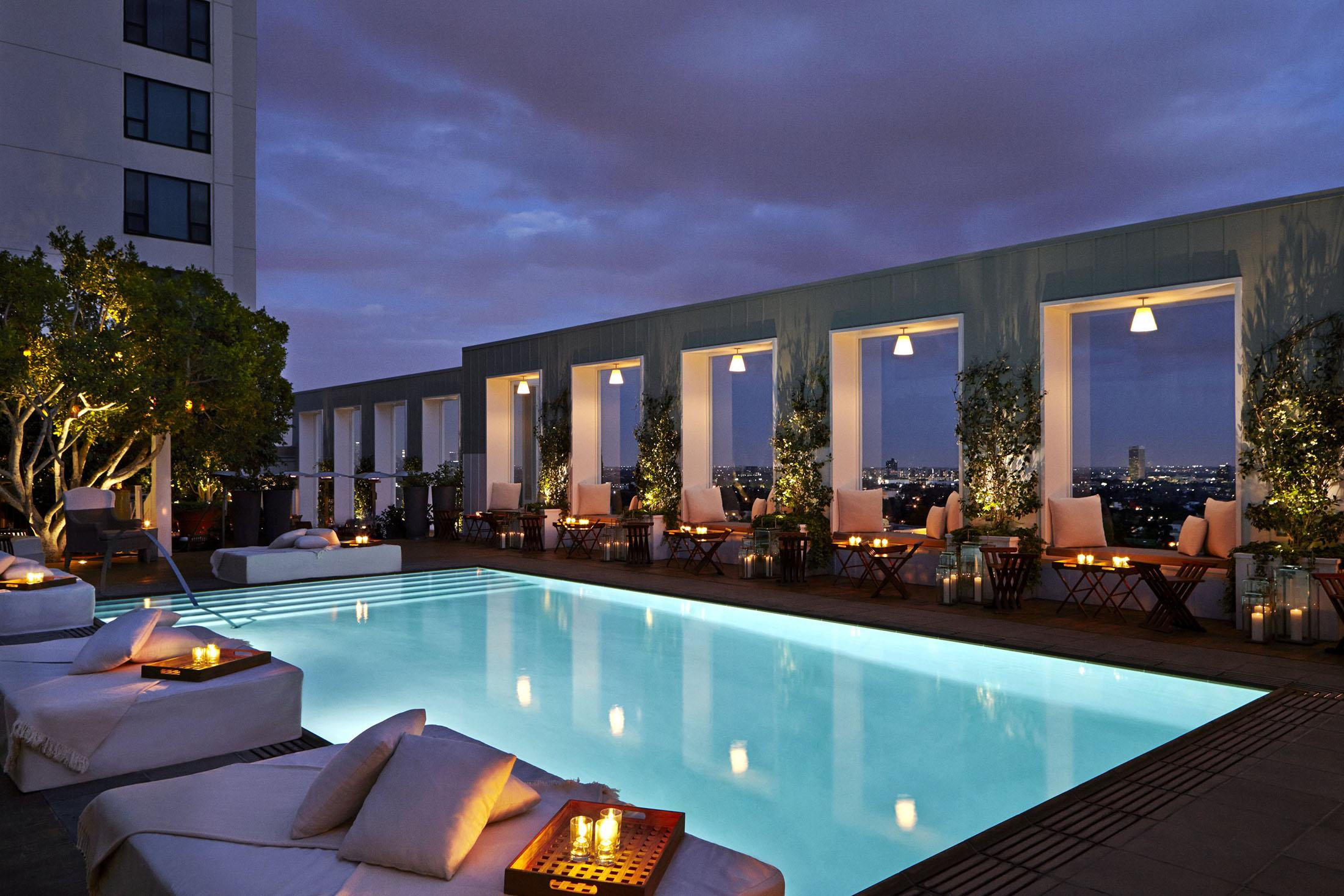 An outside pool at night.